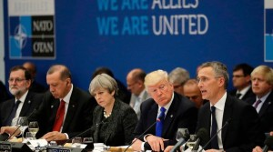 Turkey's President Recep Tayyip Erdogan (2-L), Britain's Prime Minister Theresa May (C), US President Donald Trump (2-R) look on as NATO Secretary General Jens Stoltenberg speaks during a working dinner meeting at the NATO (North Atlantic Treaty Organization) headquarters in Brussels on May 25, 2017 during a NATO summit. / AFP PHOTO / POOL / Matt Dunham (Photo credit should read MATT DUNHAM/AFP/Getty Images)